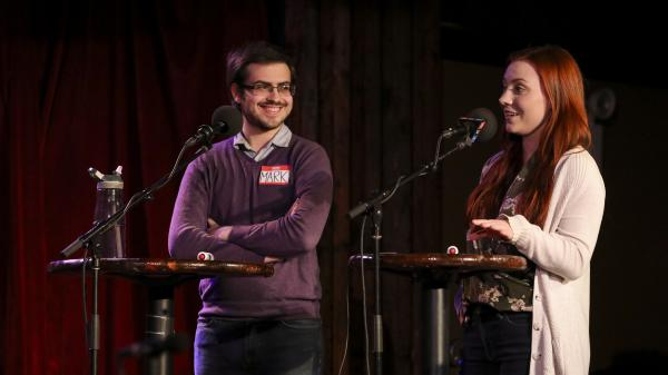 Contestants Mark Gartsbeyn and Elizabeth Foland appear on <em>Ask Me Another</em> at the Bell House in Brooklyn, New York.