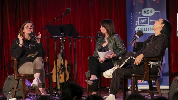 Lesyle Headland and Greta Lee play a game on <em>Ask Me Another</em> at the Bell House in Brooklyn, New York.