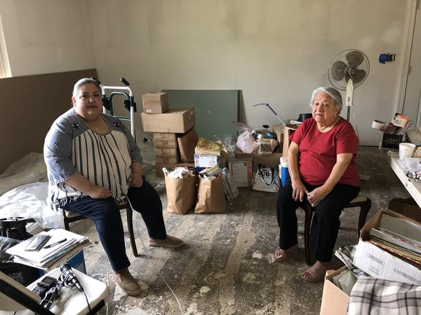 Alice and Dolores Torres sit in their stripped-down Houston home.