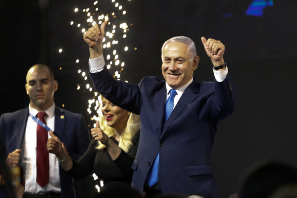 Israel's Prime Minister Benjamin Netanyahu waves to his supporters in Tel Aviv after polls for Israel's general elections closed.