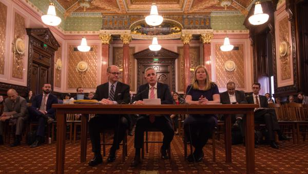 Democratic state Sen. Don Harmon, left, presented the graduated income tax constitutional amendment to the Senate Executive Committee Wednesday. He was joined by Deputy Gov. Dan Hynes and Emily Miller, a policy adviser to the governor.