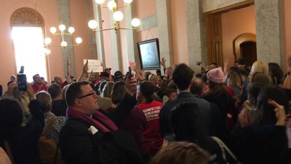 Dozens of pro-choice and pro-life protestors demonstrated outside the House chamber before the vote.