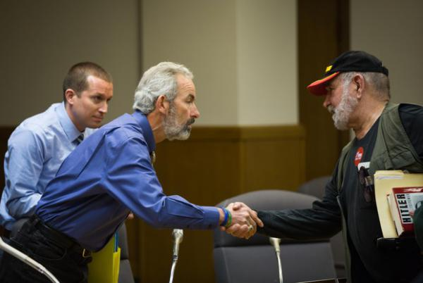 <p>State Sen. Floyd Prozanski, D-South Lane and North Douglas counties, greets a member of the public at the conclusion of the Oregon Senate Judiciary Committee's hearing on Senate Bill 978 the Oregon Capitol in Salem, Ore., Tuesday, April 2, 2019. An opponent of the gun control bill shares his thoughts with the head of the committee after it adjourns.</p>