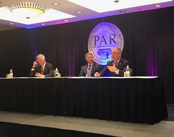 Robert Travis Scott (center), President of PAR, moderates a forum between gubernatorial candidates Congressman Ralph Abraham (left) and incumbent Governor John Bel Edwards (right).