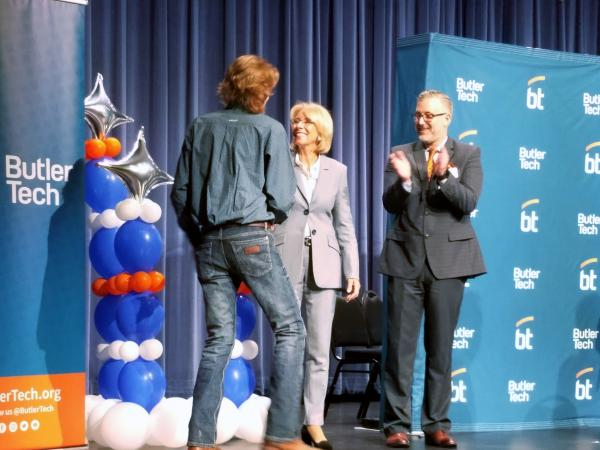 U.S. Education Secretary Betsy DeVos congratulates Butler Tech student TJ Hollon who will work at ARI-Hetra after graduation.