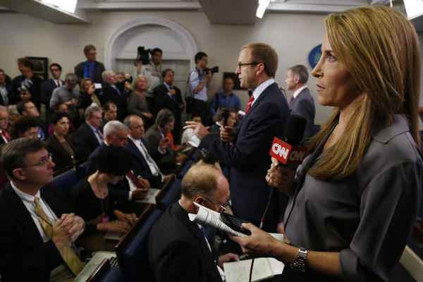 Jessica Yellin of CNN gets ready to do her stand-up from the James Brady Press Briefing Room before President Barack Obama's news conference at the White House in Washington, Tuesday, April 30, 2013. (Charles Dharapak/AP)