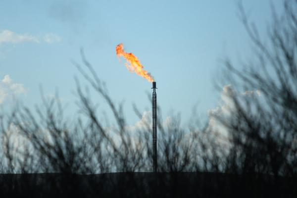 Oil well operators burn off natural gas, a byproduct of oil production, in a process called flaring.