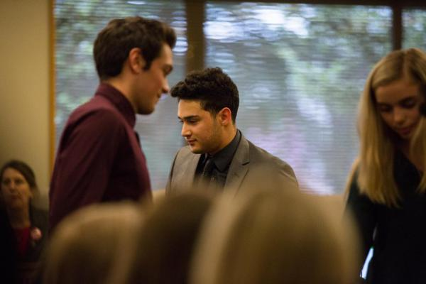 <p>Sal Najar, center, a student at Beaverton's Mountainside High School, returns to his seat after his testimony on House Bill 2019 before the Joint Committee on Student Success at the Oregon Capitol in Salem, Ore., Thursday, April 11, 2019.</p>