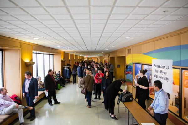 <p>People gather outside a hearing room for an opportunity to testify to theJoint Committee on Student Success at the Capitol in Salem, Ore.,on Thursday, April 11 2019.</p>