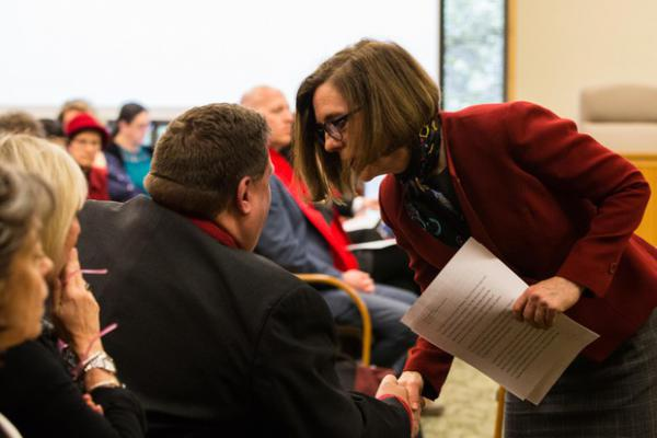 <p>Oregon Gov. Kate Brown shakes hands with Oregon Education Association President John Larson after testimony on House Bill 2019 before the Joint Committee on Student Success at the Oregon Capitol in Salem, Ore., Thursday, April 11, 2019.</p>