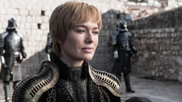 Queen Cersei (Lena Headey) smiling that smile of hers on <em>Game of Thrones.</em> Shoulder pads courtesy of Julia Sugarbaker.