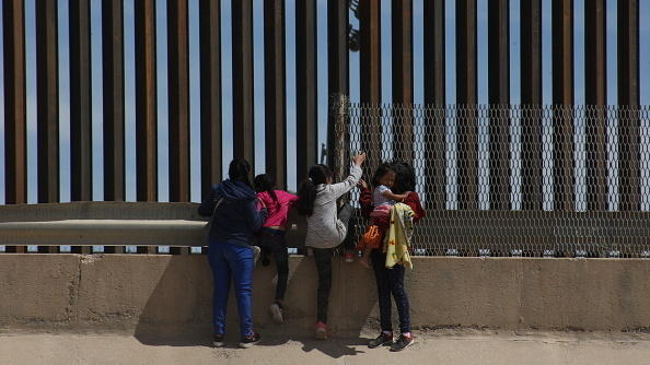 A mother and her three daughters at the border crossing dividing Juárez, Mexico, and El Paso, Texas, on April 9. The family traveled from Guatemala to reach the U.S.