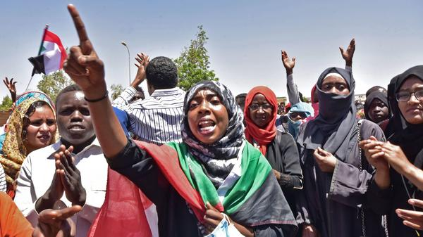 Sudanese demonstrators gather near military headquarters in the capital Khartoum on Monday. Organizers said they were resisting an attempt to disperse the sit-in where thousands of people have camped out for days.