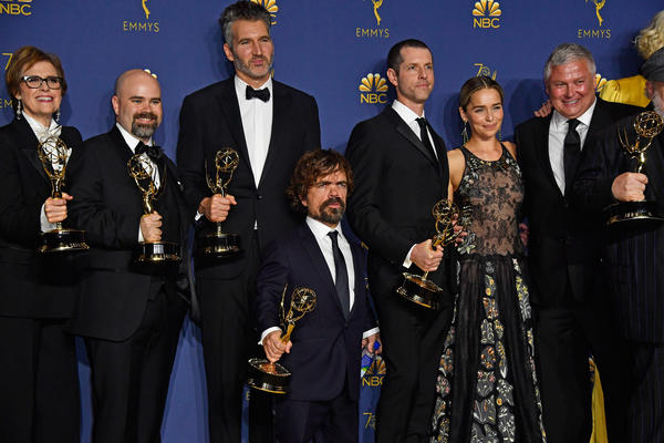 Members of the cast and crew of 'Game of Thrones' pose at the 70th Emmy Awards. The show's eighth and final season premieres on April 14.