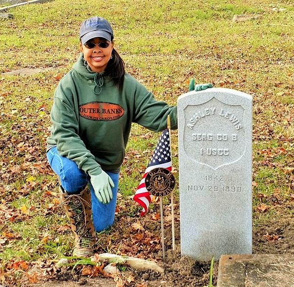 Nadia Orton stands with the replacement gravestone she secured for African American Civil War veteran Sgt. Ashley H. Lewis (1842-1890), 1st U.S. Colored Cavalry. She has replaced 20 gravestones for African American Civil War veterans, most from various co