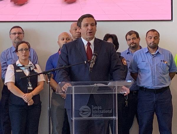 Gov. Ron DeSantis speaks at Tampa International Airport Monday.
