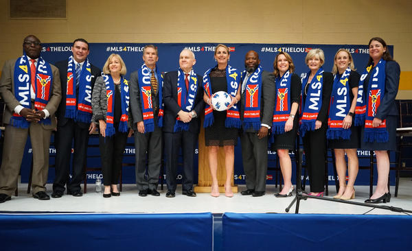 St. Louis civic leaders, members of the Taylor family, which owns Enterprise Holdings, and World Wide Technology CEO Jim Kavanaugh announce plans to form a bid to attract a Major League Soccer expansion team in St. Louis on Oct. 9, 2018.