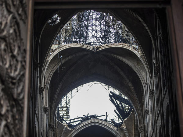 Damage seen from inside Notre Dame Cathedral in Paris on Tuesday. President Emmanuel Macron has set a five-year goal to rebuild the cathedral after Monday's blaze.