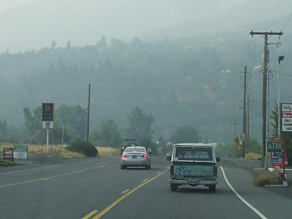 <p>Driving into Ashland, Oregon, the hills are shrouded in wildfire smoke.</p>