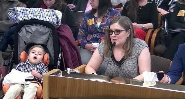 """<p>Nikki Monaco and her son Emmett present to a public hearing in Salem.</p> <p>""""If we had screened him at birth, we could have treated him at birth and he would have had a much better outcome,"""" said Monaco.</p>"""