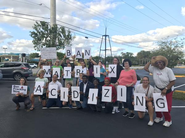 """Rally-goers lined up with signs Wednesday evening in Oakland Park to spell out their message for Gov. Ron DeSantis: """"Ban Matrix Acidizing."""" The type of fracking uses acid to extract oil from underground."""