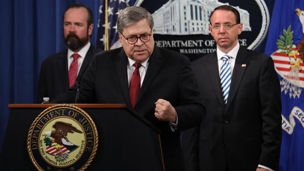 Attorney General William Barr speaks about the redacted version of the Mueller report as U.S. Deputy Attorney General Rod Rosenstein (right) and U.S. Acting Principal Associate Deputy Attorney General Ed O'Callaghan listen at the Department of Justice Thursday before the document's release.