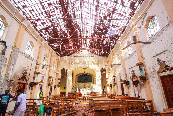 Sri Lankan officials inspect St. Sebastian's Church in Negombo, north of Colombo, Sri Lanka's capital, after a series of explosions on Easter Sunday at churches and hotels across Sri Lanka killed nearly 300 people and wounded hundreds more.