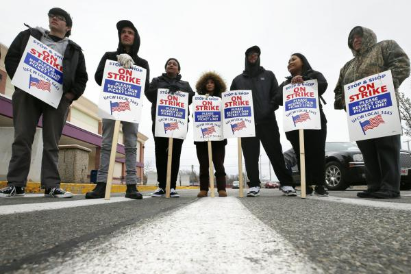 Striking workers stand on a picket line outside the Stop & Shop supermarket in Revere on Thursday. A tentative deal ending the strike was reached on Sunday. (Michael Dwyer/AP)