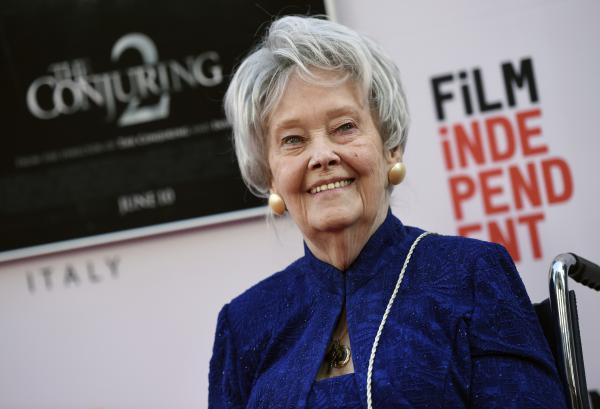 """Paranormal investigator and film consultant Lorraine Warren poses at the premiere of the film """"The Conjuring 2"""" during the Los Angeles Film Festival at the TCL Chinese Theatre in Los Angeles in 2016."""
