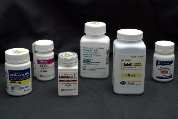 Bottles of antidepressant pills Wellbutrin (L-R) , Paxil, Lexapro, Effexor, Zoloft and Fluoxetine.
