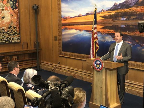 Gov. Polis speaks to reporters Monday about his first 100 days in office.