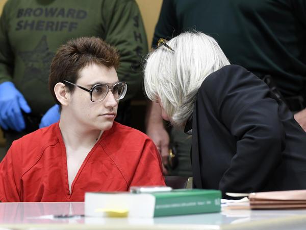 Nikolas Cruz speaks to public defender Diane Cuddihy, right, during a hearing in March.