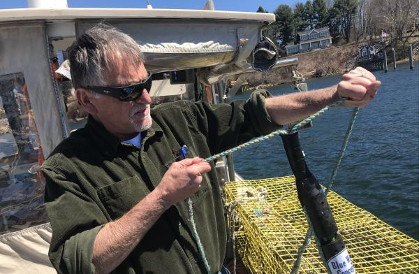 Ben Brickett tests out his time tension line cutter in the Piscataqua river