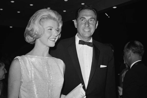 Day arrives with husband Marty Melcher for the 1960 Academy Awards ceremony. She was nominated in the best actress category that year for her role in <em>Pillow Talk</em>.