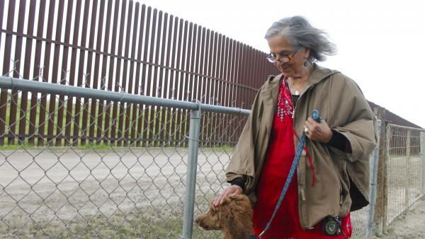 Eloisa Tamez of El Calaboz, Texas, walks along the border wall in her backyard. She took the government to court over surveying her land and over the compensation she received for the land needed for border wall construction.