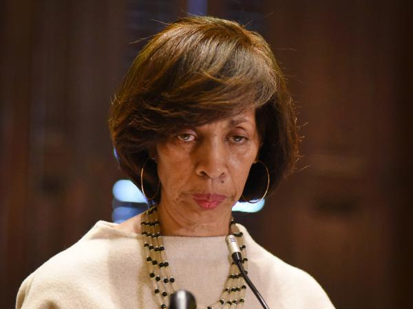 Mayor Catherine Pugh offers background on her <em>Healthy Holly</em> book business during a City Hall news conference in March.