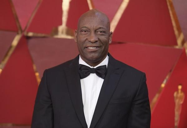 This March 4, 2018 file photo shows John Singleton at the Oscars in Los Angeles. Oscar-nominated filmmaker John Singleton has died at 51.