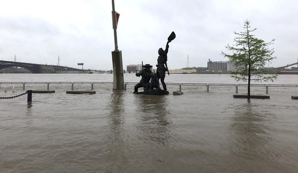 A statue of explorers Lewis and Clark is surrounded by floodwaters along the St. Louis riverfront on Thursday.