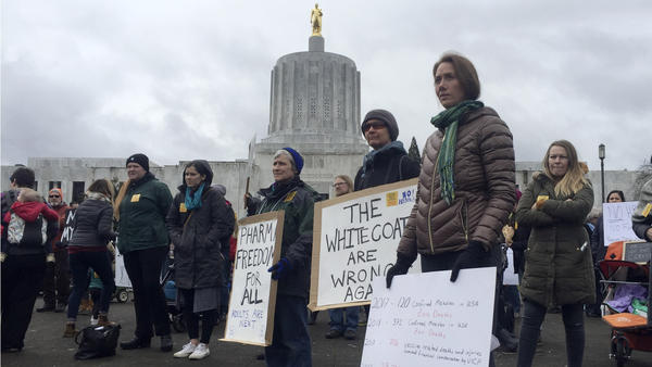 Hundreds of people rally in March at the Oregon State Capitol in Salem, protesting a proposal to tighten school vaccine requirements Similar rallies were held in April.