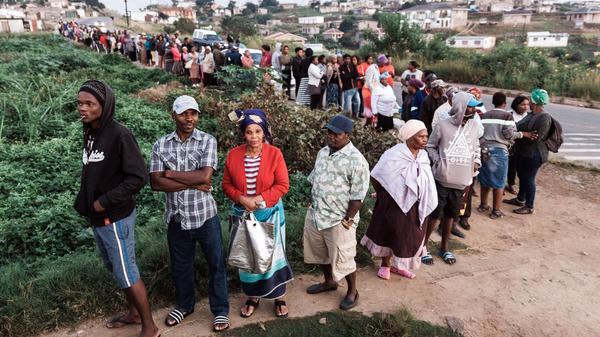 Hundreds of South African voters wait in long lines outside of a polling station in Durban on Wednesday.