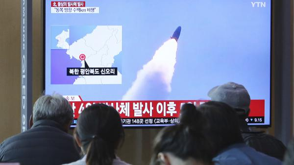 North Korea on Thursday fired projectiles that are believed to be missiles from the country's western area, South Korea's military says. The same day in Seoul, people watch a TV showing footage of a previous missile launch by North Korea.