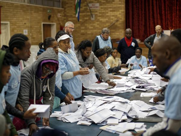 Electoral workers count ballots in view of party agents after the close of polls at the Parkhurst Primary School in Johannesburg, South Africa this week.