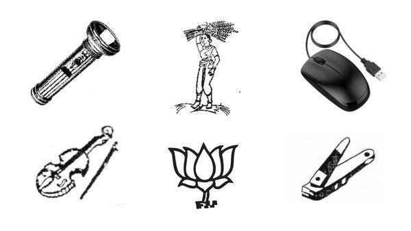 """India offers hundreds of symbols for political parties. The flashlight, """"lady farmer"""" and lotus blossom (Prime Minister Modi's party symbol) appear on voting machine ballots for elections this spring. No party claimed the violin, the computer mouse and the nail clippers."""