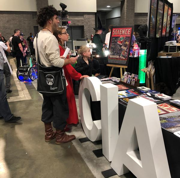 The CIA had a booth at the recent Awesome Con gathering for movie and comic book superheroes in Washington. It's one quirky example of the way the spy agency is reaching out to a broader potential pool of recruits.