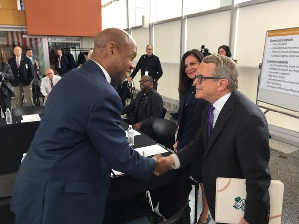 Gov. Mike DeWine (right) shakes hands with Ronnie Dunn, associate professor at Cleveland State University and a member of the Ohio Collaborative Community-Police Advisory Board.