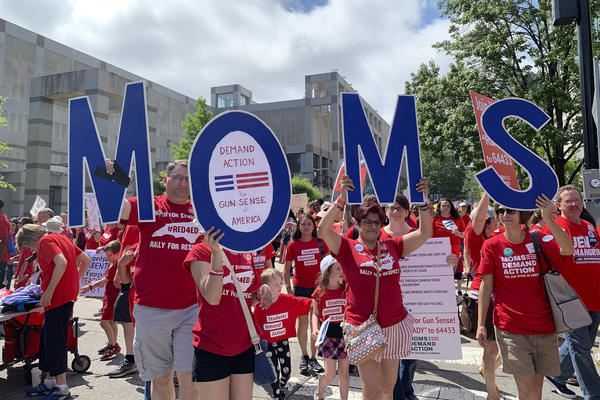 Members of Moms Demand Action march in support of teachers Wednesday, May 1, 2019, during a teacher rally, in Raleigh, N.C.