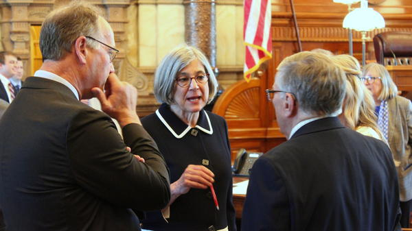 Senate President Susan Wagle, center, talks with Sens. Jeff Longbine, left, and Ed Berger as the chamber rejected Gov. Laura Kelly's nominee for an appellate court.