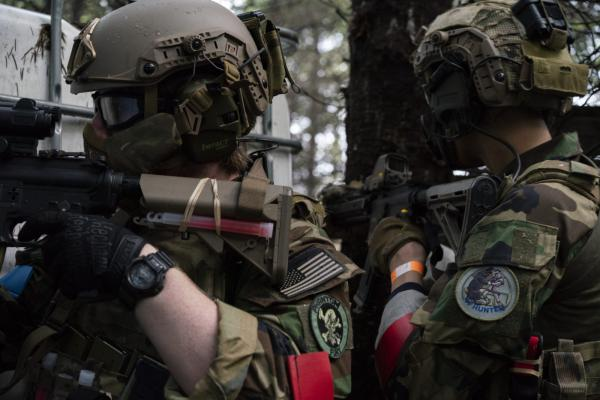 Noah Wenger and Alex Bates look for opponents during an AirSoft game at Action Acres AirSoft on March 23, 2019, in Canby, Oregon.