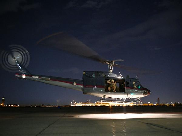 "The State Department ordered ""non-emergency"" U.S. government employees out of Iraq on Wednesday. A helicopter carrying U.S. Secretary of State Mike Pompeo is seen taking off from Baghdad International Airport last week."