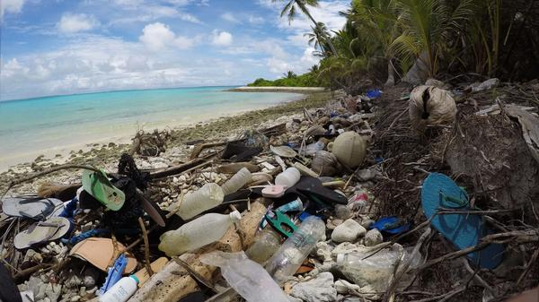 Debris blankets the north side of one of the Cocos Keeling Islands in the Indian Ocean. Researchers found a huge amount of plastic both onshore and buried in the sand.